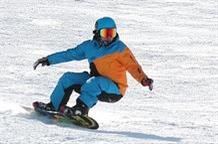 Snowboarder Carving the Slopes